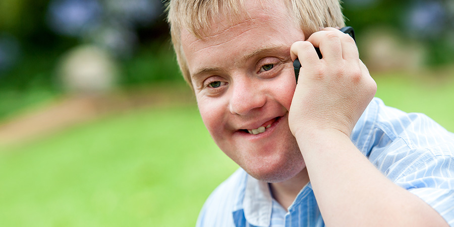Handicapped boy talking on cell phone